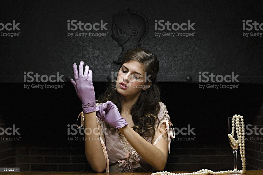 Woman putting on a purple glove 免版稅 stock photo
