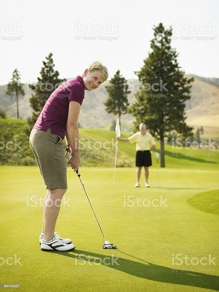 Woman putting on green, man holding flag  royalty-free stock photo