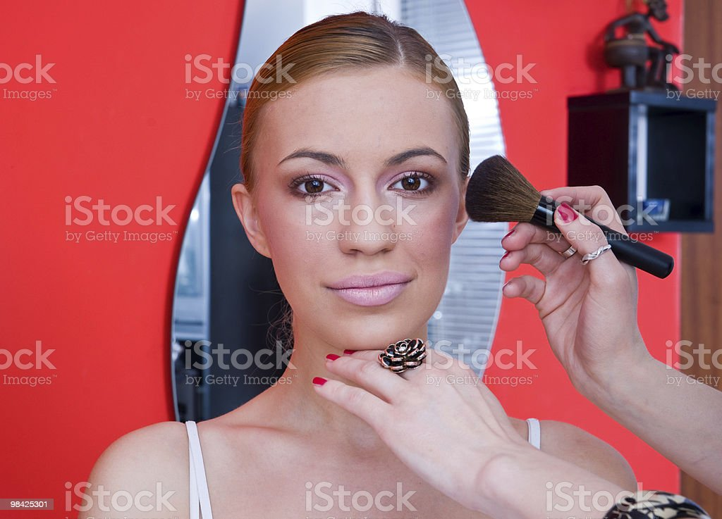 woman putting on make up royalty-free stock photo
