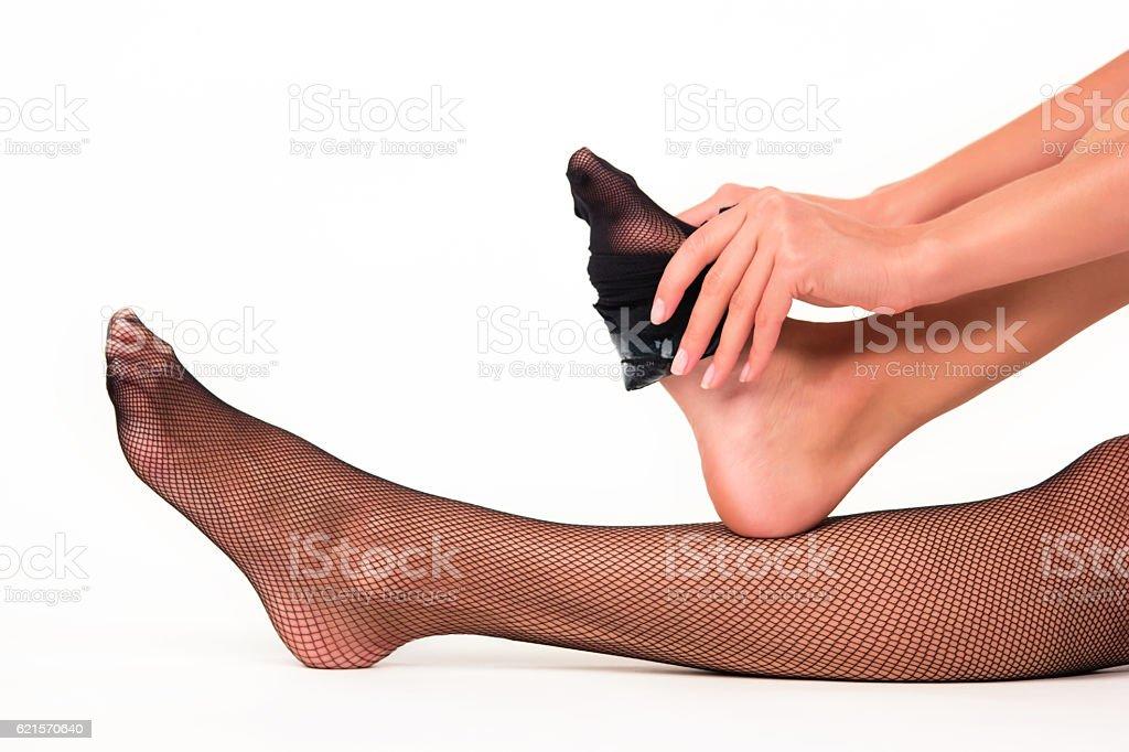 Woman putting on stockings. photo libre de droits