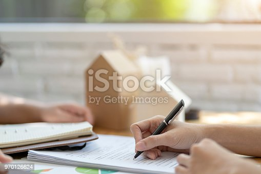 Woman putting signature on document  loan contract, real estate purchase, success business contract deals with sale represent.