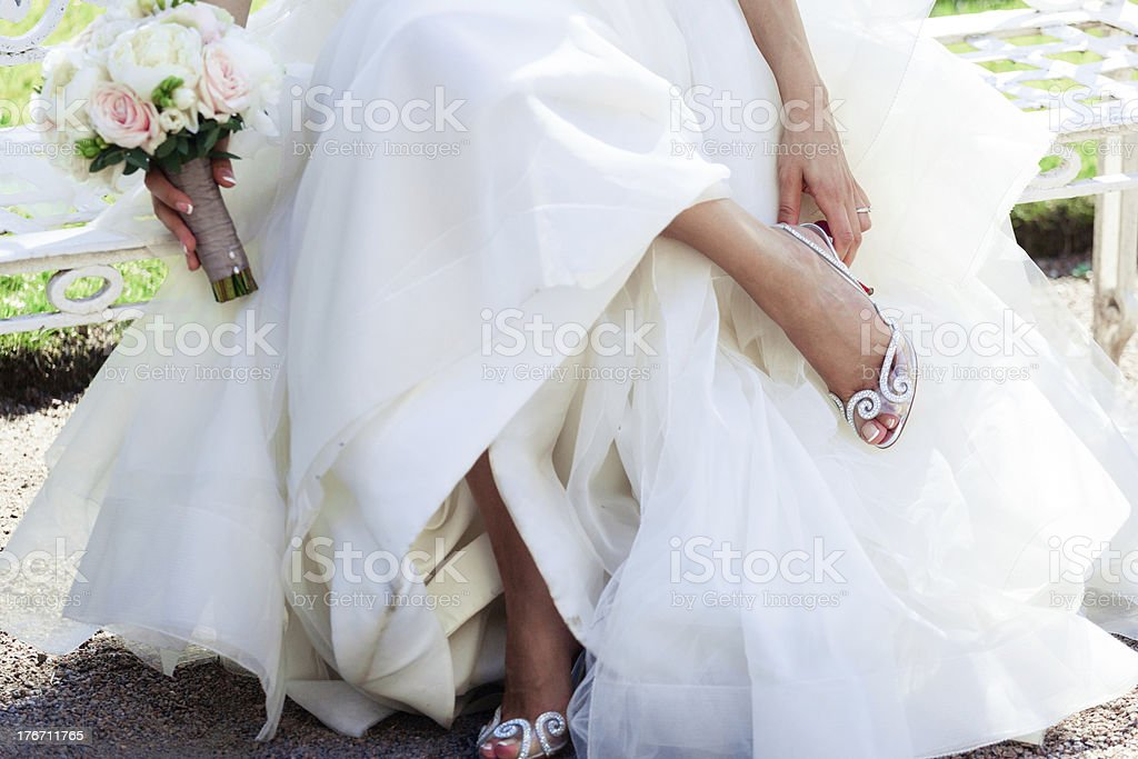 woman putting some shoe on stock photo