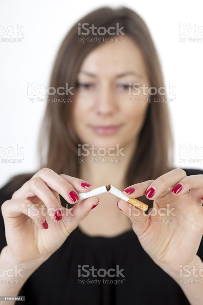Woman quits smoking stock photo