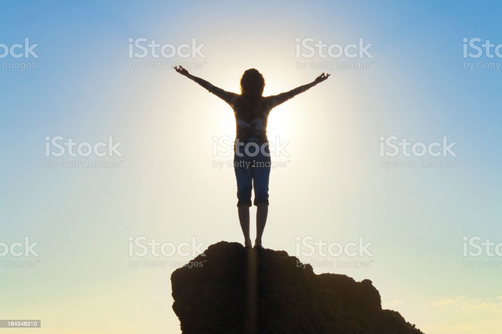 Woman Raising Arms In Hope stock photo
