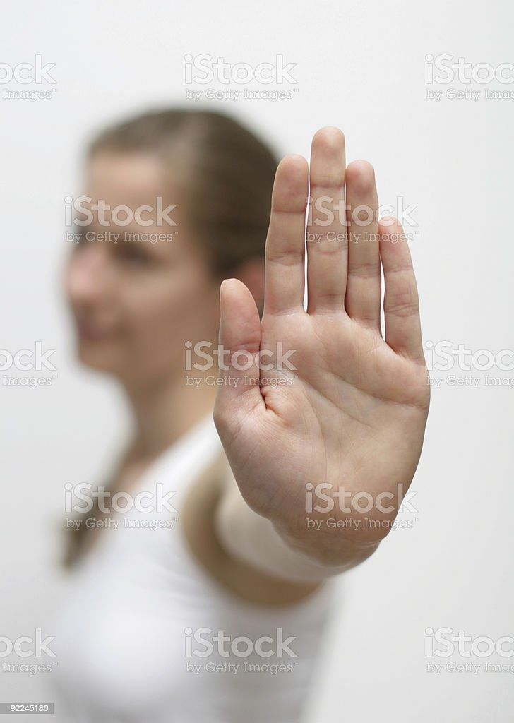 Woman raising hand and showing stop royalty-free stock photo