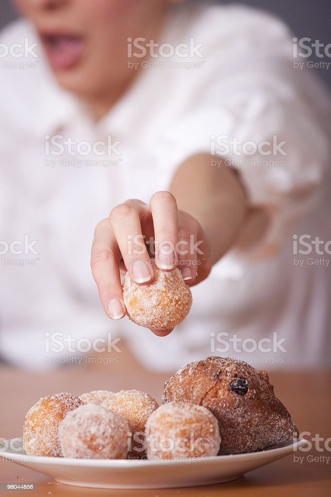 woman reaches for sugar cake royalty-free stock photo