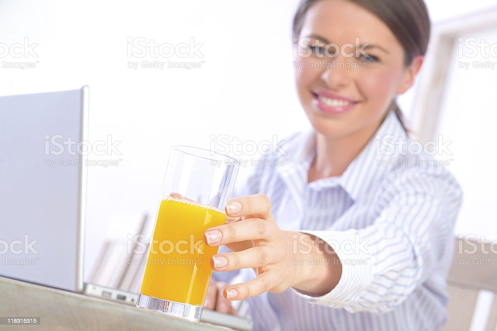 A woman reaching for an orange juice royalty-free stock photo