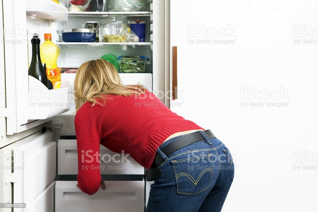 Woman reaching into pantry drawer royalty-free stock photo