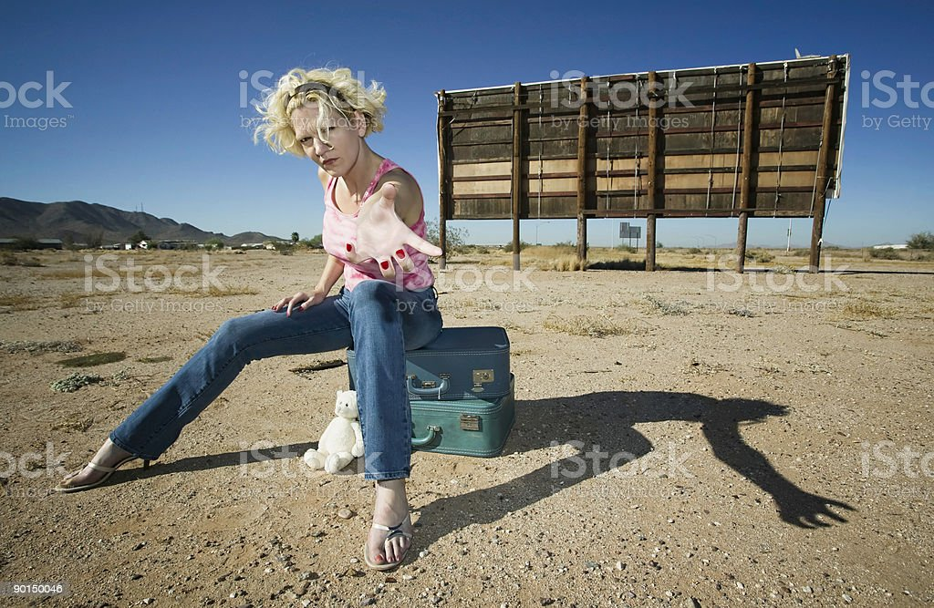 Woman reaching royalty-free stock photo