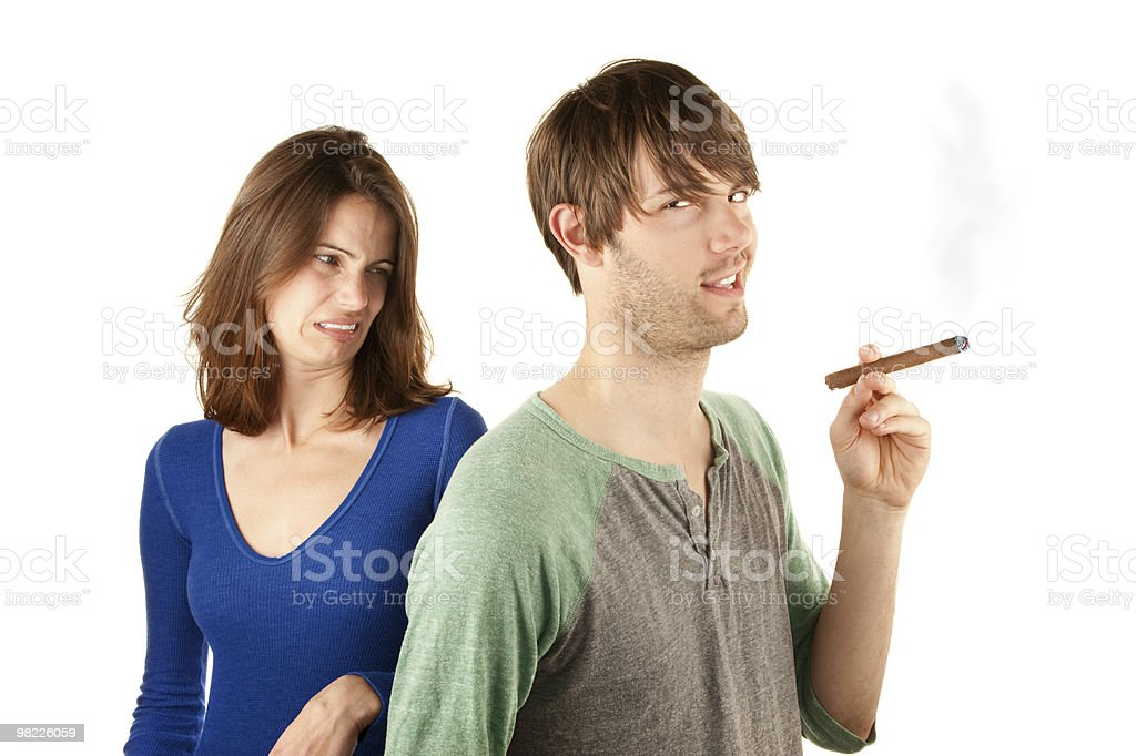 Woman reacts to man with cigar royalty-free stock photo