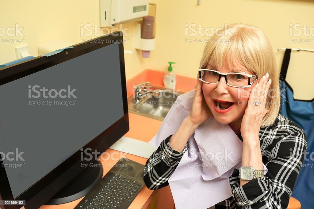 Woman reacts to steep cost of dental work stock photo
