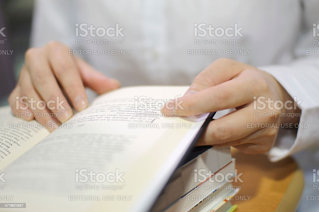 Woman reading a book at the library royalty-free stock photo
