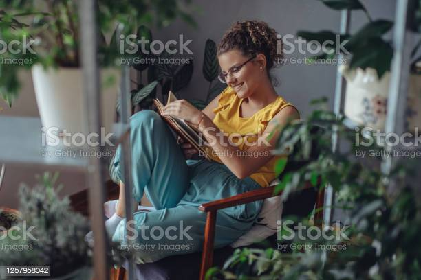 Woman reading a book in room of plants young florist in eyeglasses picture id1257958042?b=1&k=6&m=1257958042&s=612x612&h=s9te11eutoryuoiovgmqaxoja8zv  cd4rnqat0jb g=