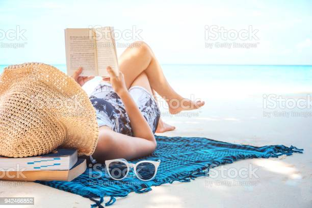 Woman reading a book on the beach in free time summer holiday picture id942466852?b=1&k=6&m=942466852&s=612x612&h=fxeqbr6nkfpt5daqfzol1aqx0vrqjsx9821mcuisq g=