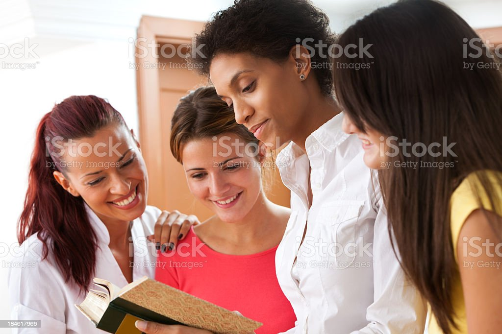 Woman Reading A Book To Group Of People royalty-free stock photo