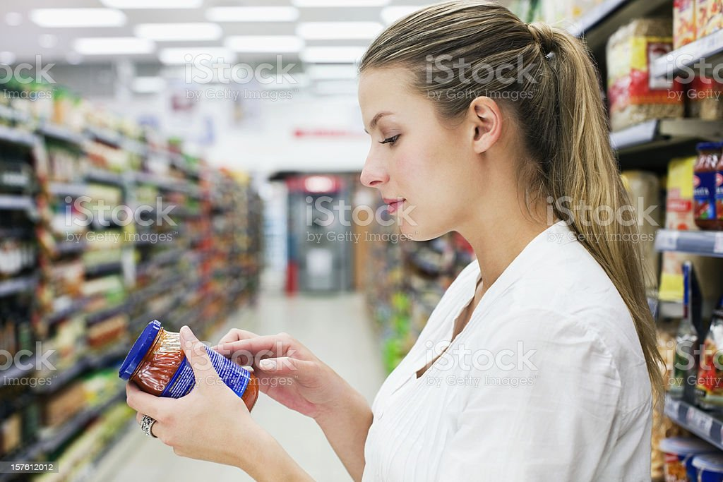 Woman Reading a Food Label royalty-free stock photo