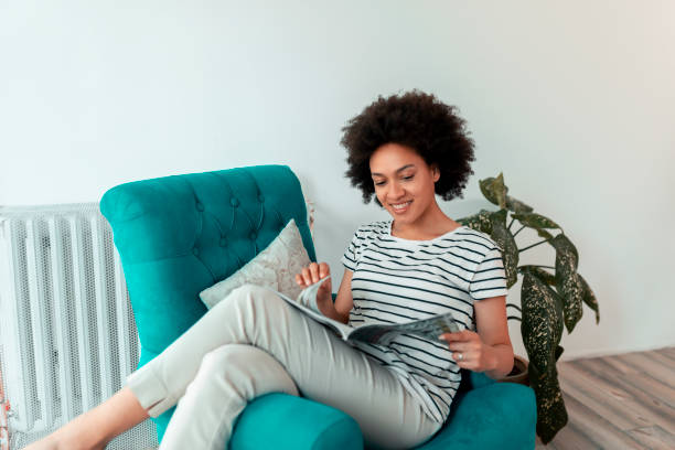Woman reading a magazine stock photo