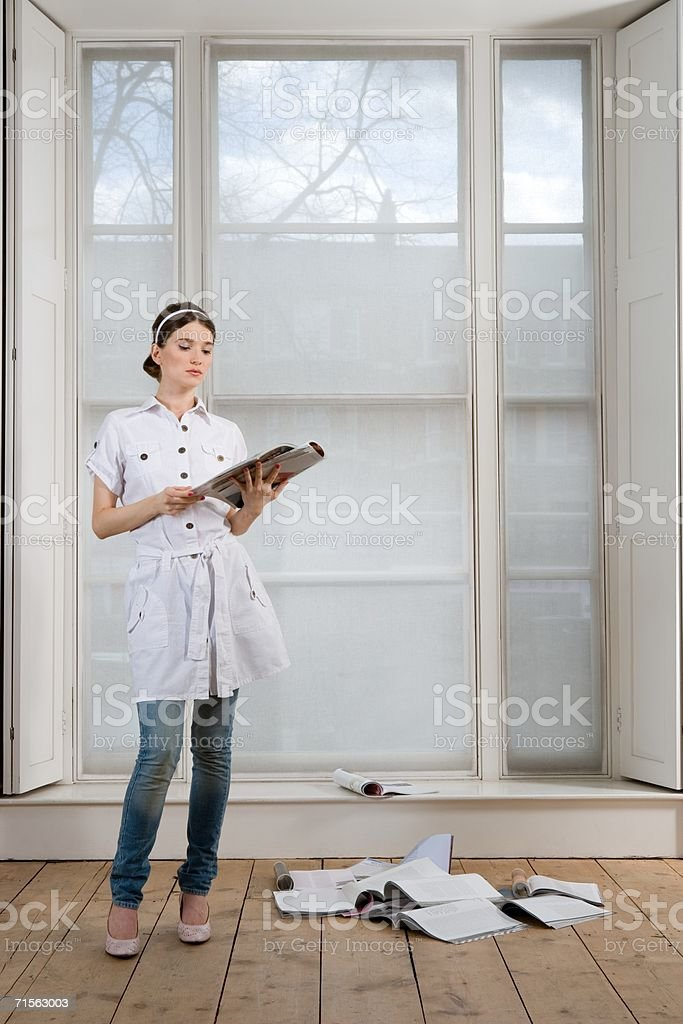 Woman reading a magazine royalty-free stock photo