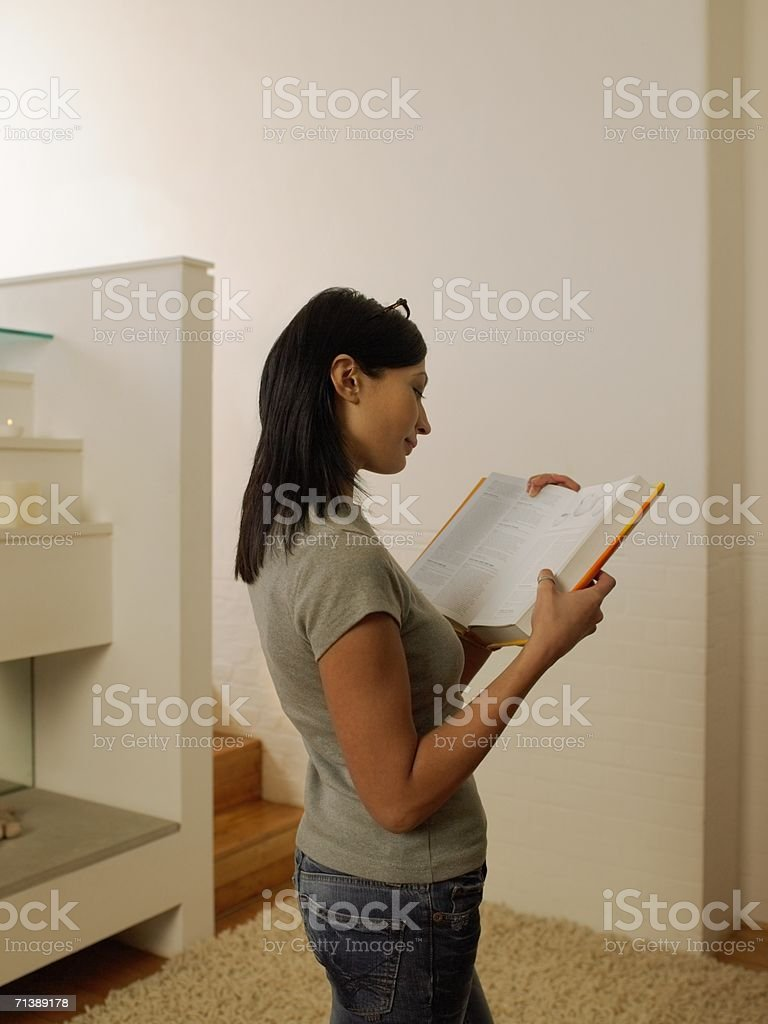 Woman reading a reference book royalty-free stock photo