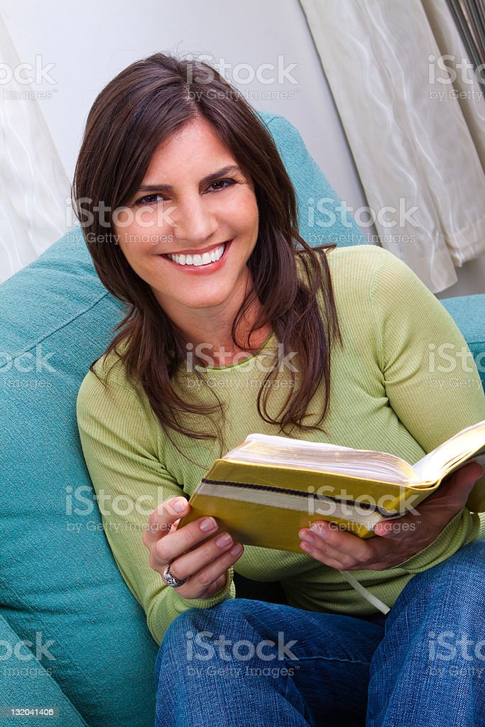 Woman Reading and Smiling royalty-free stock photo