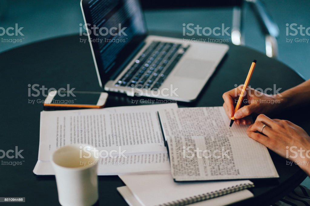 Woman reading and working at home stock photo