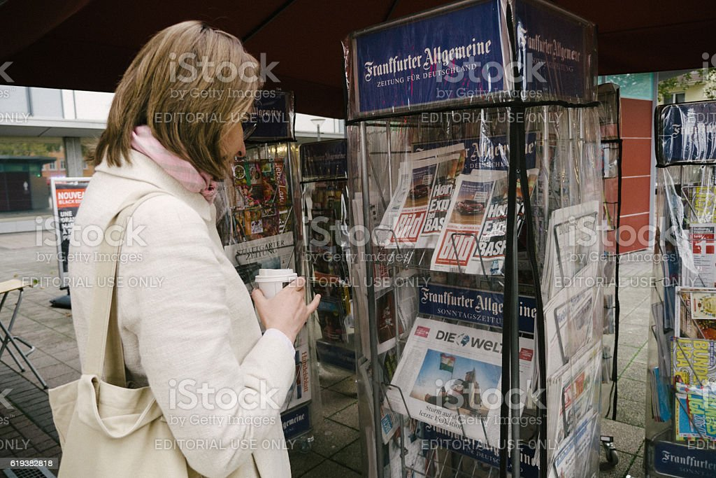 Woman Reading At Press Kiosk About Basf Explosion At Ludwigshafe