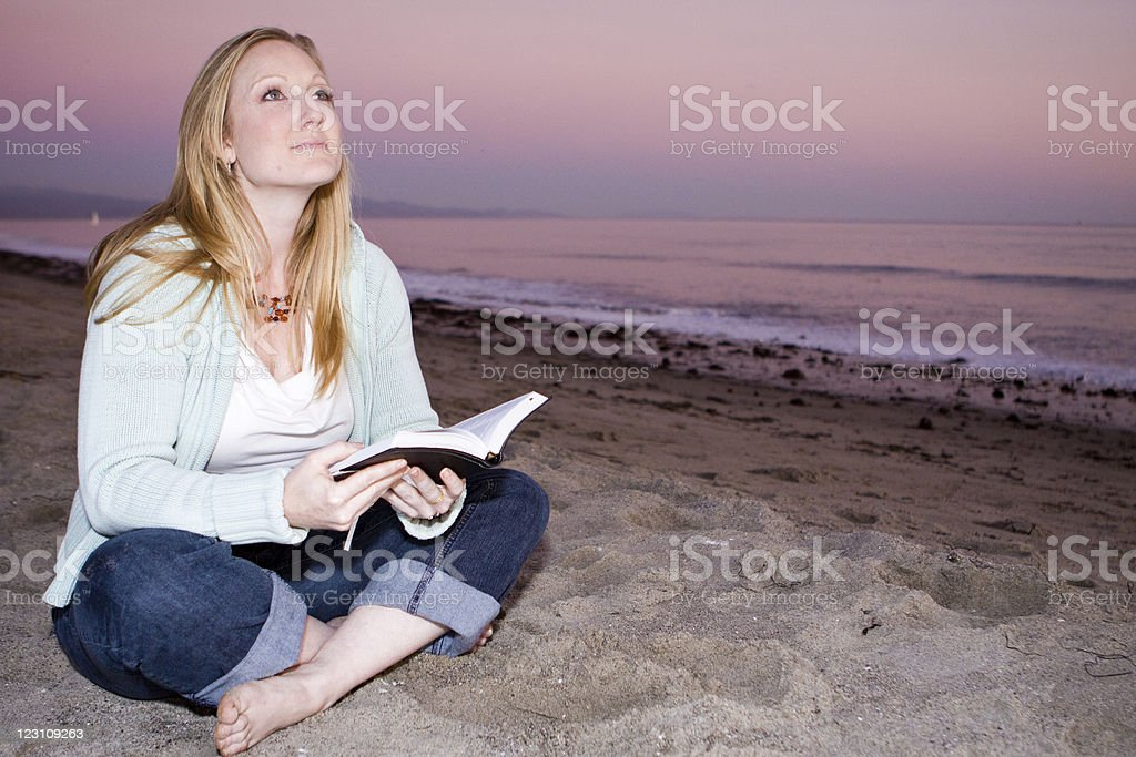 Woman reading at the beach royalty-free stock photo