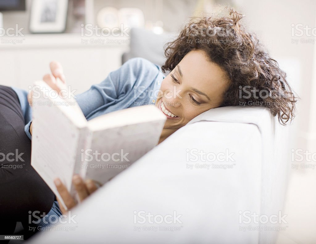 Woman reading book at home royalty-free stock photo