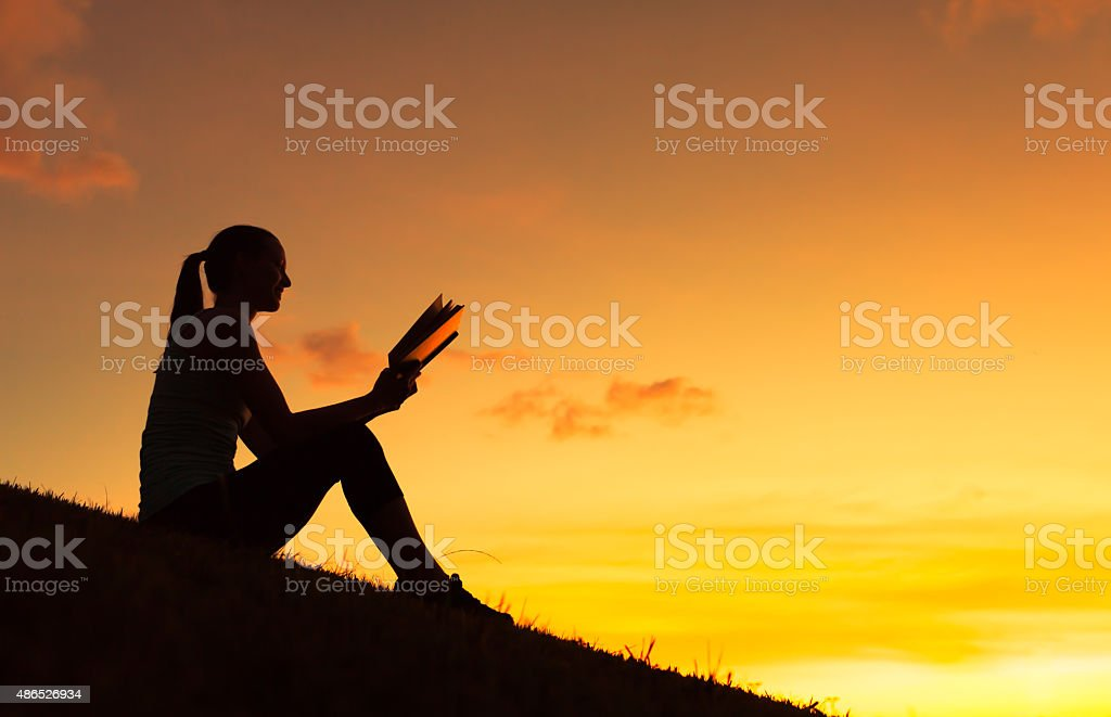 Woman reading book stock photo