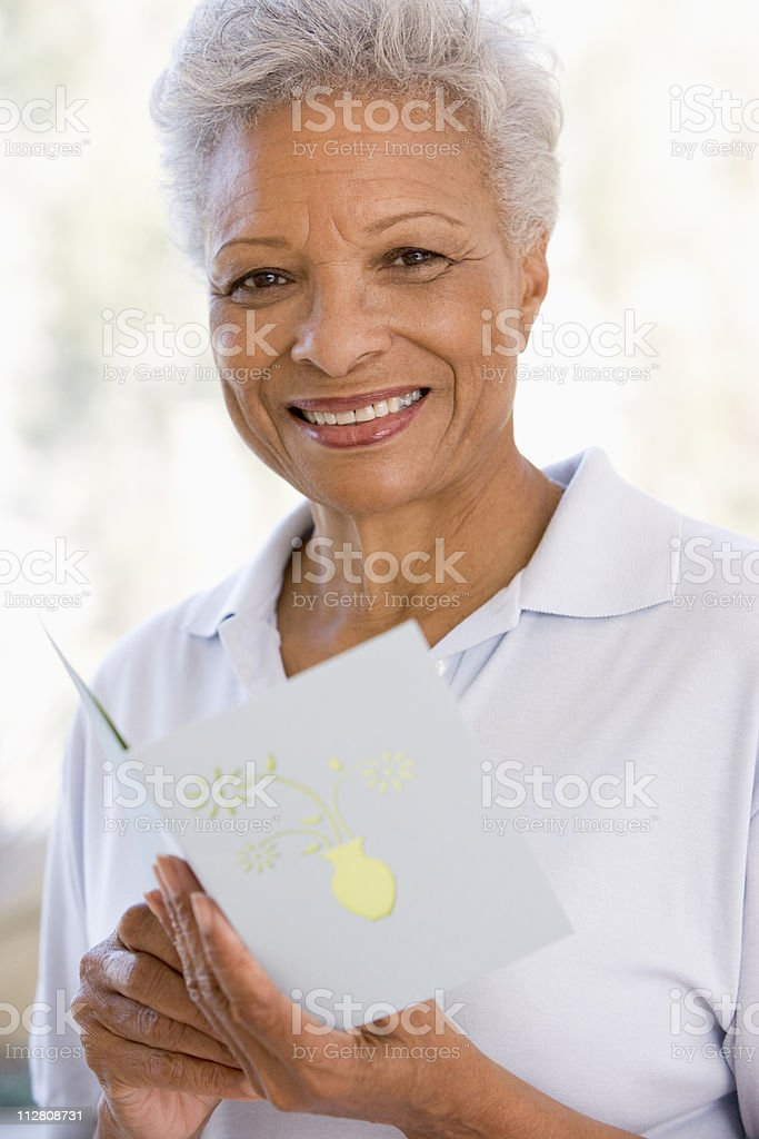 Woman reading card and smiling royalty-free stock photo