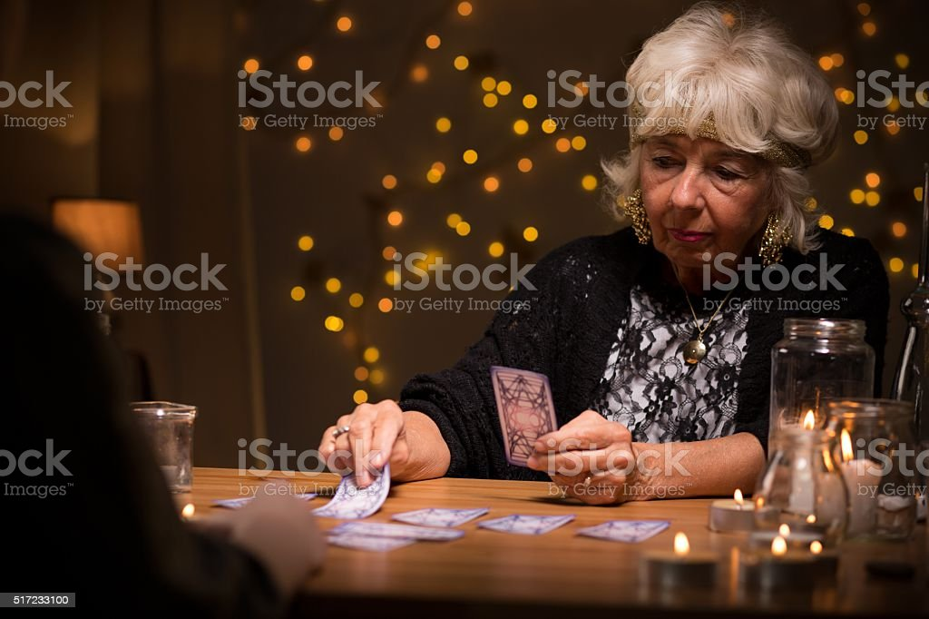 Woman reading cards stock photo