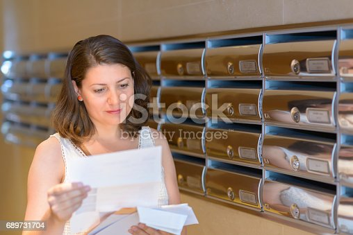 Beautiful woman reading correspondence
