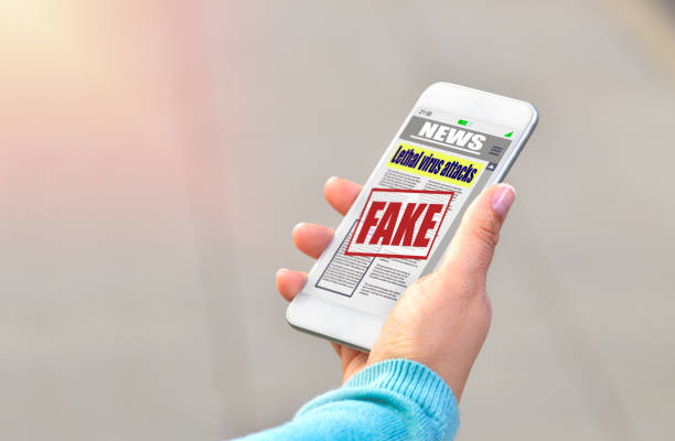woman reading digital fake news on smartphone stock photo
