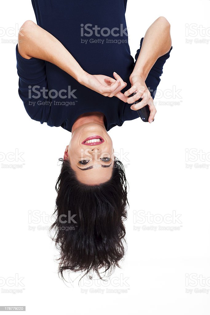 woman reading emails on smart phone upside down stock photo