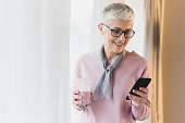 istock Woman reading message on her phone 1130303025