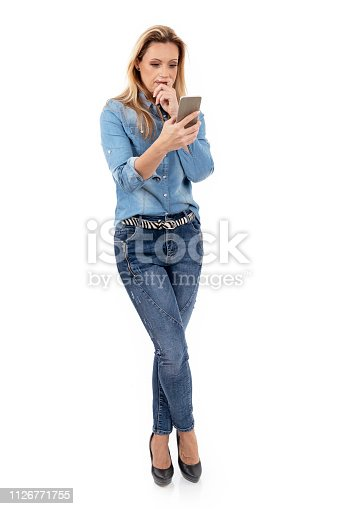 istock Woman reading message on the phone 1126771755