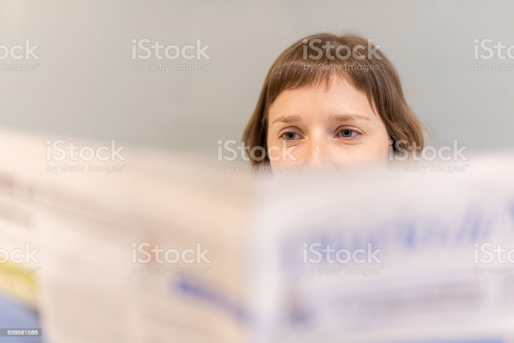 Woman reading newspaper royalty-free stock photo
