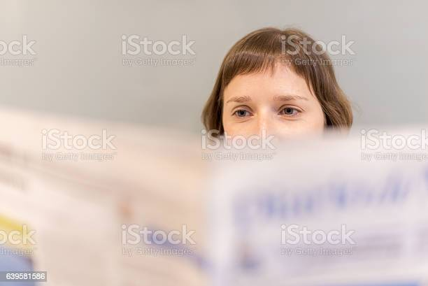 Woman Reading Newspaper Stock Photo - Download Image Now