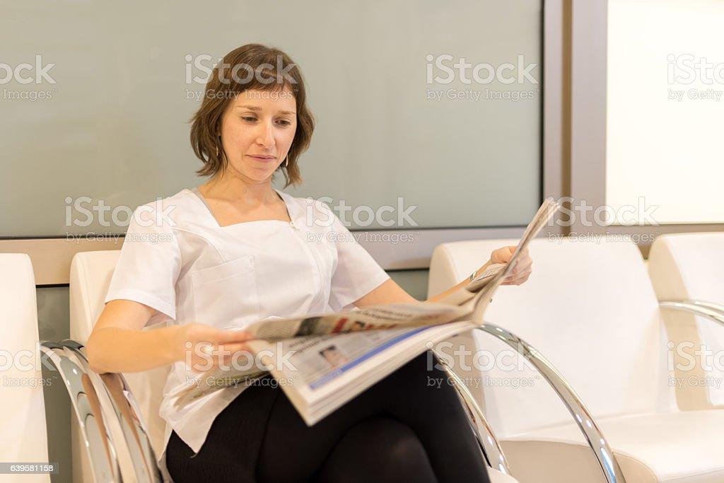 Woman reading newspapper royalty-free stock photo