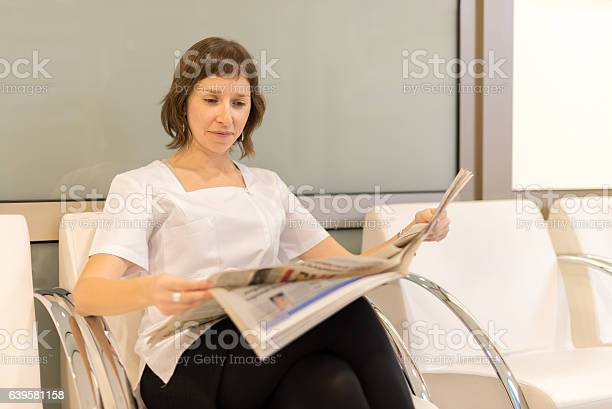 Woman Reading Newspapper Stock Photo - Download Image Now