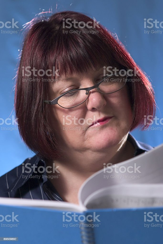Woman reading notebook royalty-free stock photo