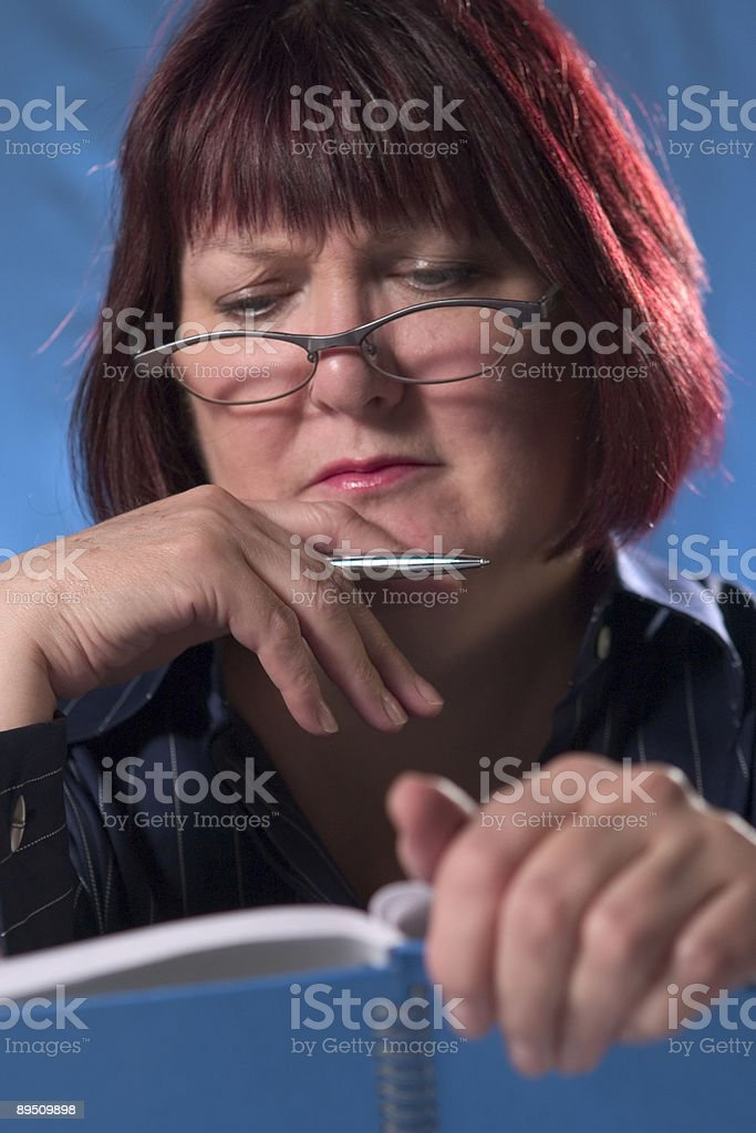 Woman reading notes royalty-free stock photo