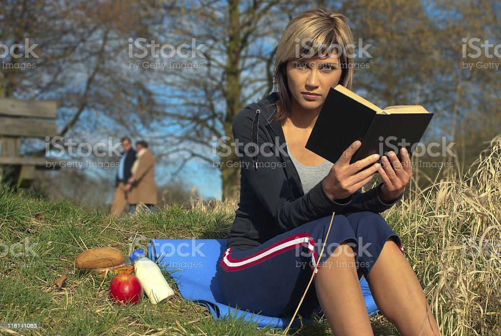 Woman Reading on Grass royalty-free stock photo