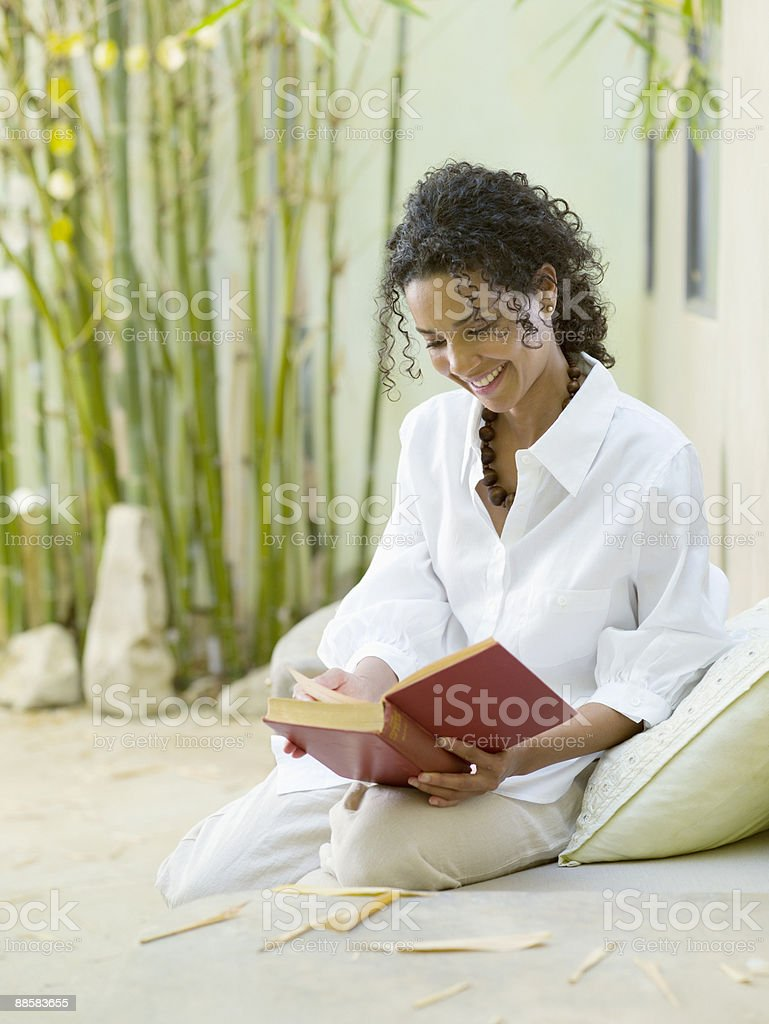Woman reading on patio royalty-free stock photo