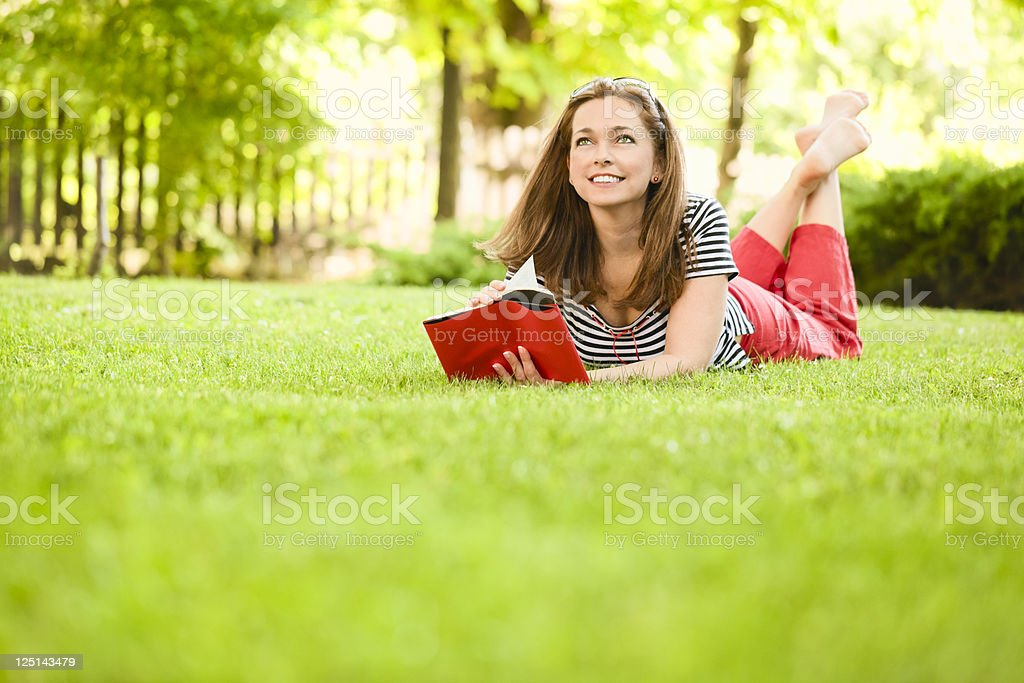 Woman reading outdoors royalty-free stock photo