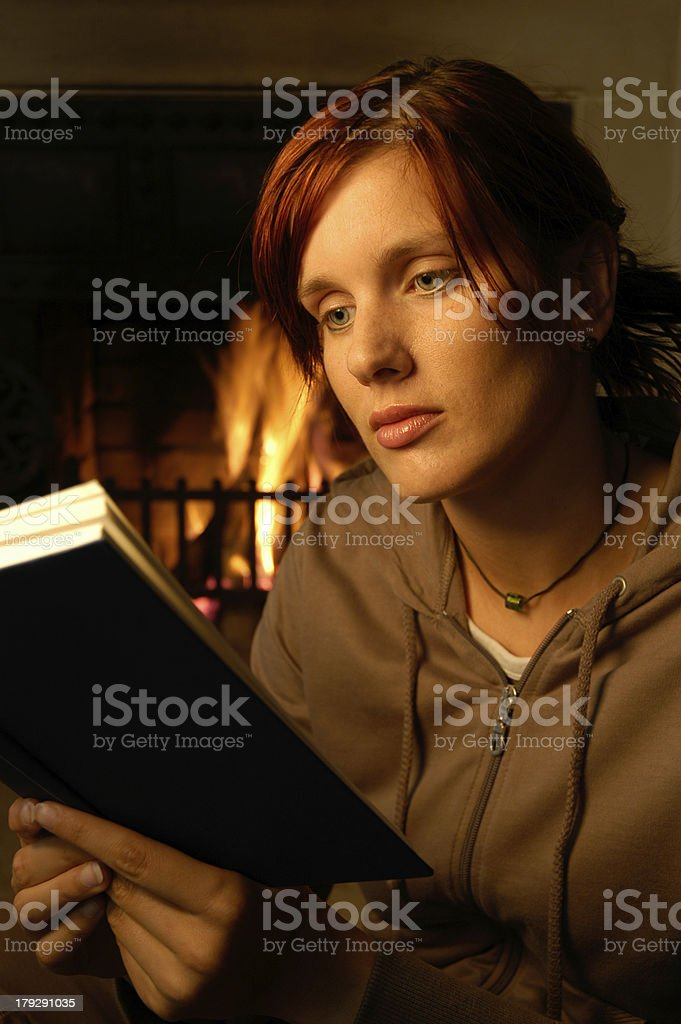 woman reading ( chimney behind) royalty-free stock photo
