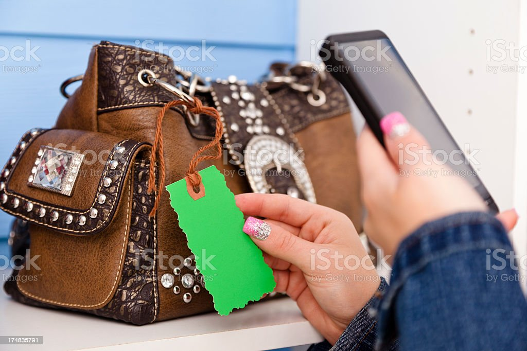Woman reading price tag code with cell phone. royalty-free stock photo