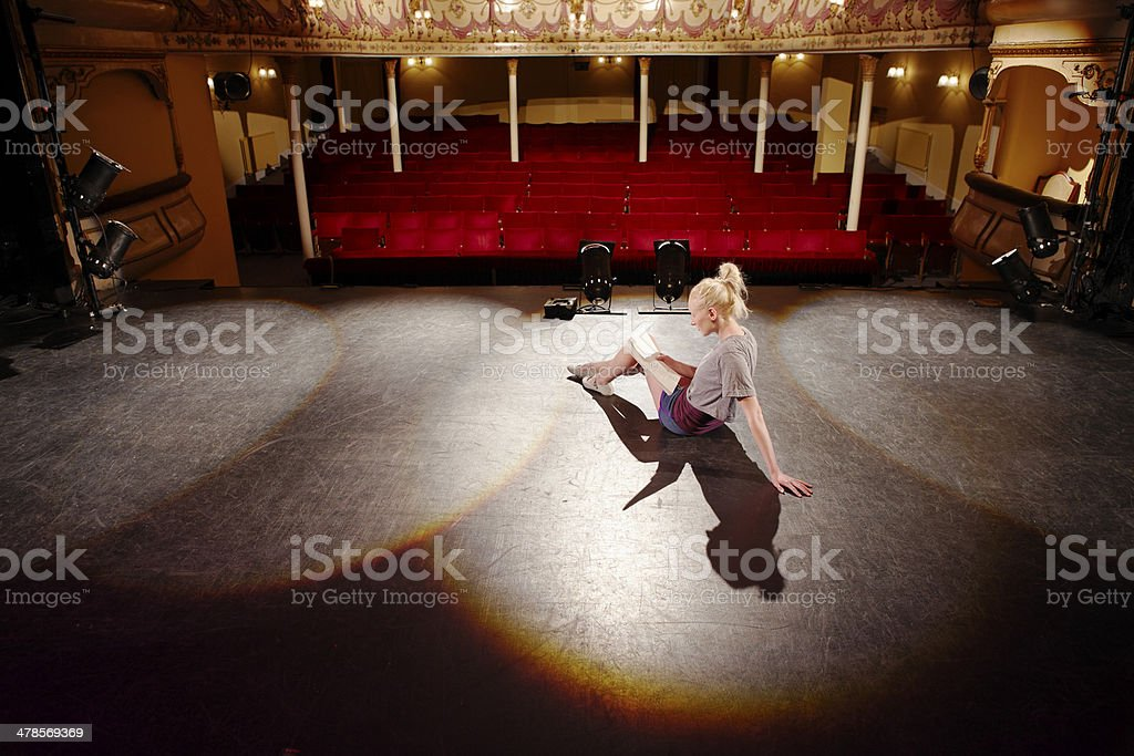 Woman Reading Script On Stage stock photo