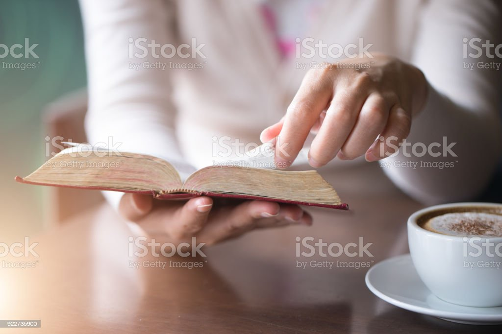 Woman reading ta book.reading bible, stock photo