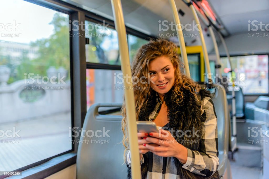Woman Reading Text Message On Bus stock photo